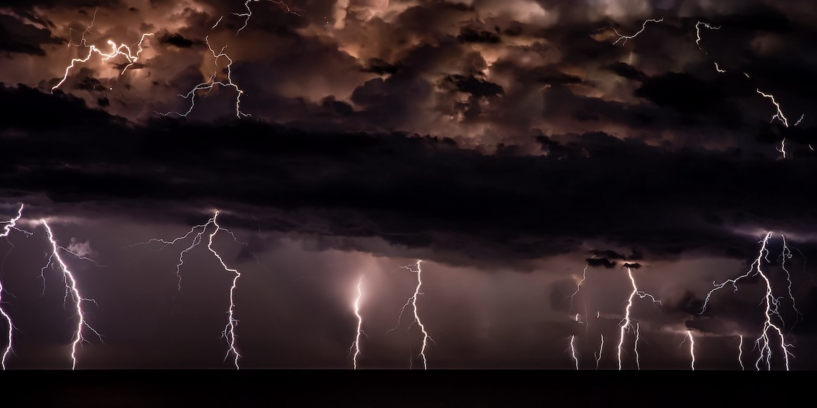 IT Risk Management being depicted through a lightning storm.
